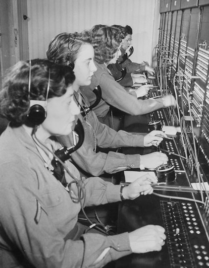 WAC telephone operators operate the Victory switchboard during the Potsdam Conference. Photo provided by National Archives and Records Administration. NAIL Control Number: NLT-AVC-PHT-63(1457)77